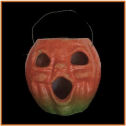 My paper mache jack-o-lantern candy cachepot. The paper features were lost long ago.