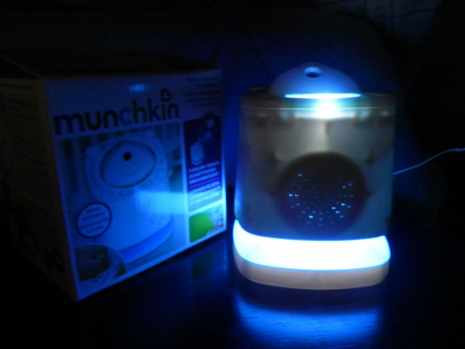 I tried to get a photo with the night light on, but unfortunately my camera wasn't agreeing with me. Still kinda neat. I love the soft blue glow!