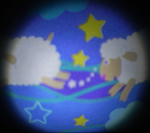 This is my favorite, the sky projection lens. It puts these cute little sheep and stars on the ceiling (or wall)