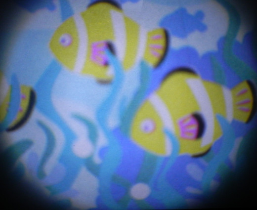cute little fish, floating across the wall! Part of the sea projection lens