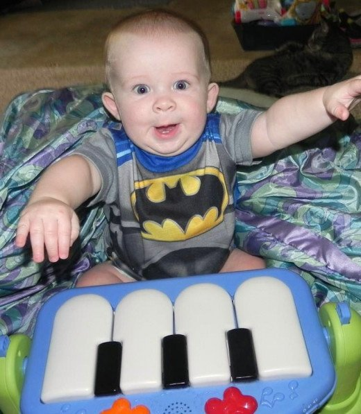 Batman plays piano don't ya' know!