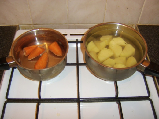 Chantenay carrots and potatoes ready to be parboiled