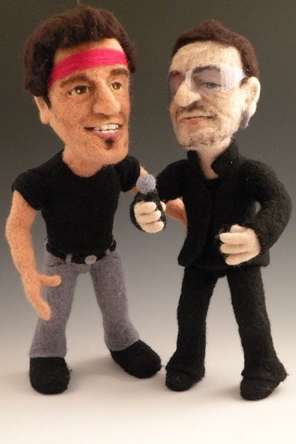 Springsteen and Bono, both have something in common. Both of them are looking sheepish. It must be the wool!