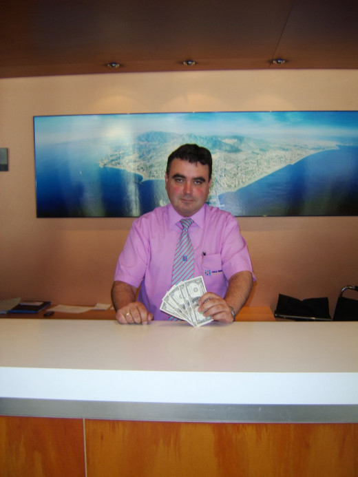 Juan, a receptionist at The Hotel Bali, Benalmadena, Spain, starts The Five Dollars off on their Vacation
