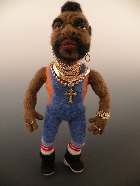 Mr. T flaunts his signature piles of gold chains. It is best not to pull his chain.