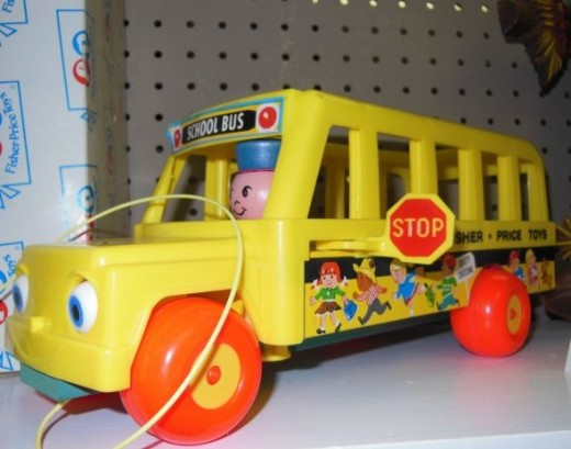 Fisher Price Vintage School Bus. Small children heading off to school for the first time can practice getting on and off the bus with their very own Little People.