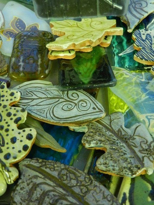 Make your own tile pieces of clay and glass or purchase from an eclectic box of treasures.
