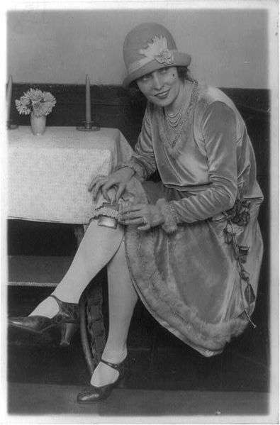 "A Lady Named ""Rhea,"" Hiding Her Flask in Her Garter During Prohibtion in 1926"