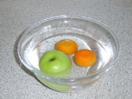 Washing the fruit in preparation to make Sangria