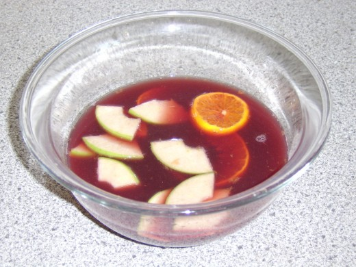 Mixing the Sangria ingredients together