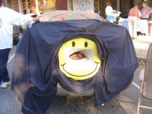 My trunk (a couple of years ago) - a big Smiley Face filled with candy