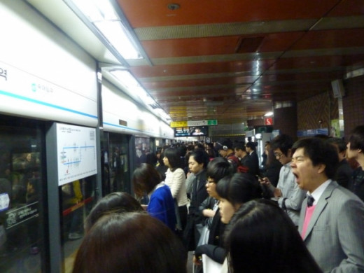 A busy rush hour at Seoul Subway, full of tired workers!