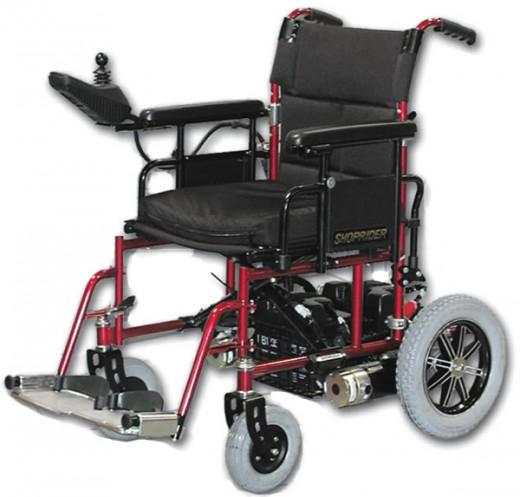 This portable power chair looks much like a manual wheelchair.