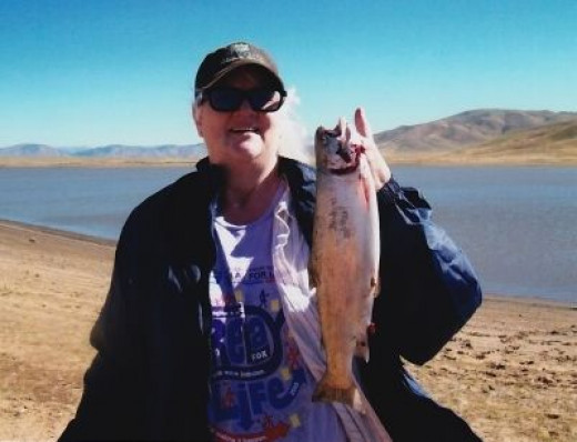 My sister Joan's first catch at Camas ! It was 18 inches and 2 lbs!