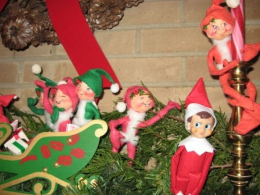 Elf on the Shelf Photo: I have lots of elfs on our mantle so Nuke claimed them as his kin and here he is visiting with some cousins.