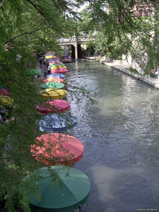 Umbrellascape along San Antonio Riverwalk - copyright 2013 Vikk Simmons