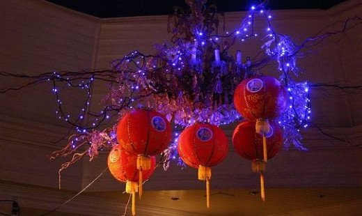 Hanging in The Sussex Arts Club, 7 Ship Street, Brighton. Made up of Paper Chinese Lanterns and festooned with blue LEDs