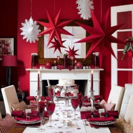 Set a festive table, Prepare your dining room for a feast with table settings and decorations in berry red and white. Just add silver and crystal details for extra sparkle and hang big, bold paper stars and snowflakes low over the table. By yossawa