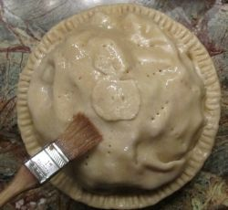 Glazing the pie with egg white