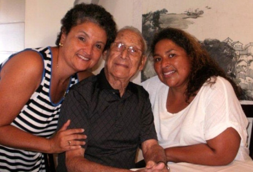 Mr. Herrera with his two loving granddaughters.