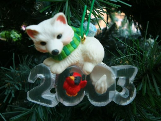 This 2003  Christmas ornament commemorates the year the foxes came to visit.