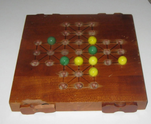 Wooden marble game. Photo Credit:  Peggy Hazelwood