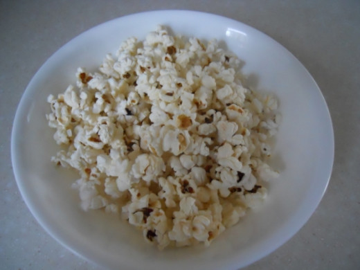 "Dump into a deep bowl. Shake so unpopped kernels fall to bottom. Pour into a dish 1"" deep."