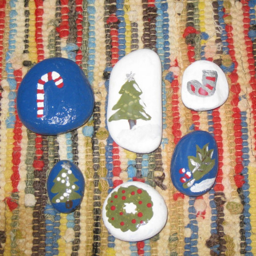 Rocks painted in Christmas motif.