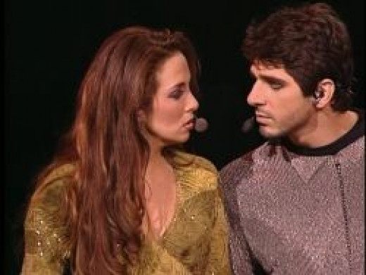 Patrick Fiori as Phoebus with Helene Segara as Esmeralda