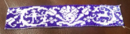 First project created on my Loom.  This is purple and white.  I designed this pattern with the inspiration from a filet pattern from 1900.