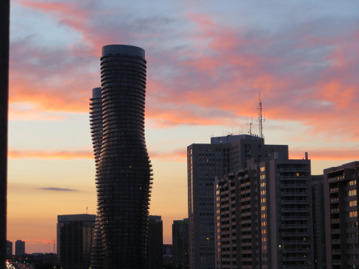 Absolute Towers at dusk in Mississauga, Ontario (also known as the Marilyn Monroe Towers)