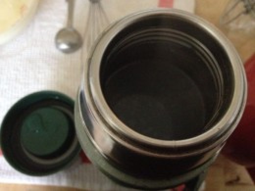 Uncapped thermos filled with boiling water