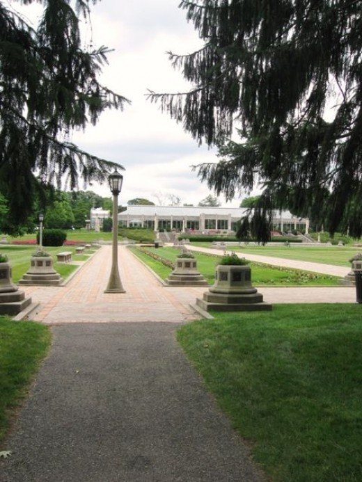 At the edge of the Sunken Gardens, looking up at the conservatory. The fountains were not running on this day.