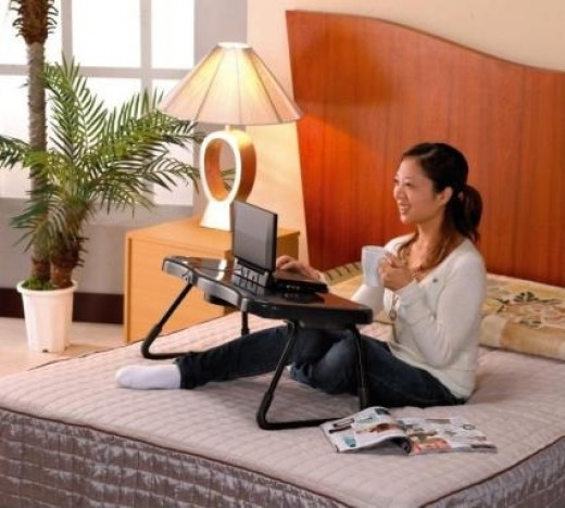 Women In Bed Laptop stand using computer.
