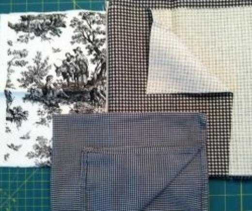 The toile and larger gingham (top right) were used for draperies and upholstery. The tiny gingham (foreground)  was used for napkins.