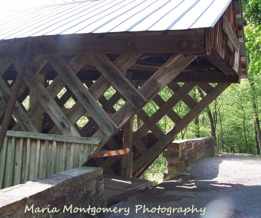 This is a side view near the entrance of the bridge, showing the pretty lattice-pattern used by the builder, Mr. Thurman Horton, in 1894.