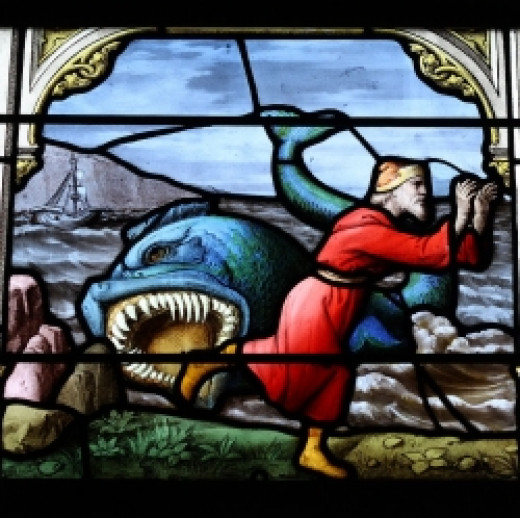 Whale Spitting up Jonah - stained glass