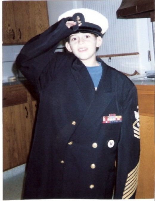 My son at 8 years old wearing Grandpas uniform. ((1994)