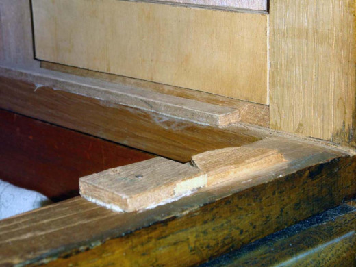 Likewise, the worn drawer runners and supports are replaced with new wood.