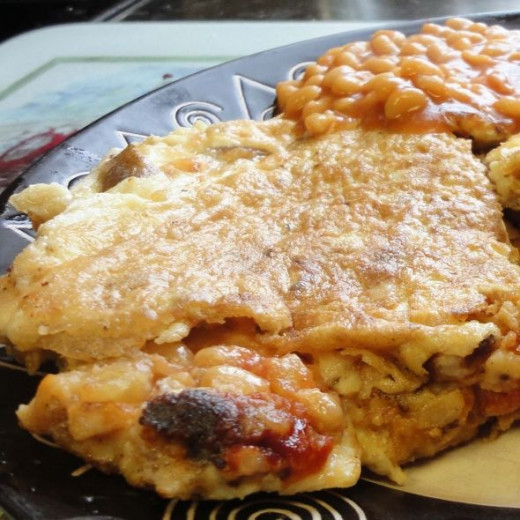 Four egg omelette with baked beans