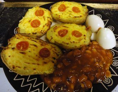 Baked Jacket Potatoes stuffed with Potato Cheese and Onion Sauce
