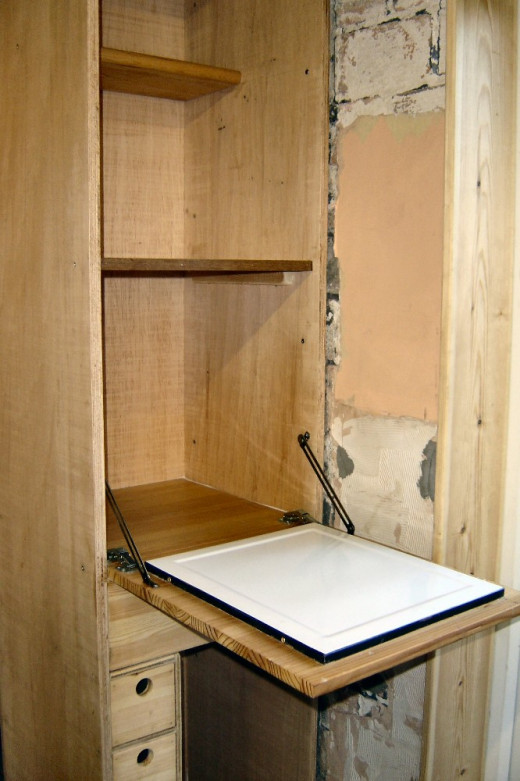 Pull down flap with enamel bread board and shelves in built in larder