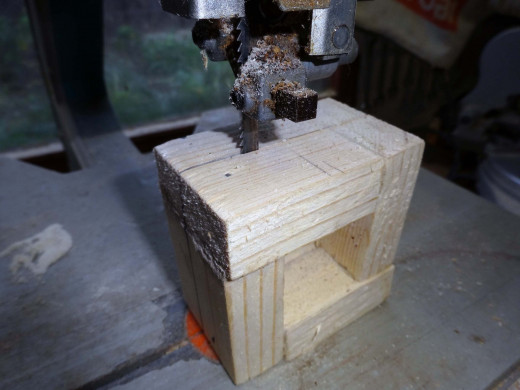 Cutting the wooden tube into small square.