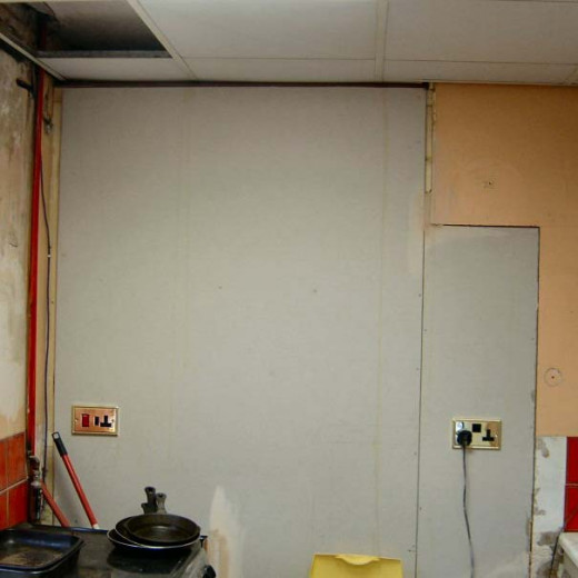Plasterboard over stud wall in kitchen behind which is the new cloakroom