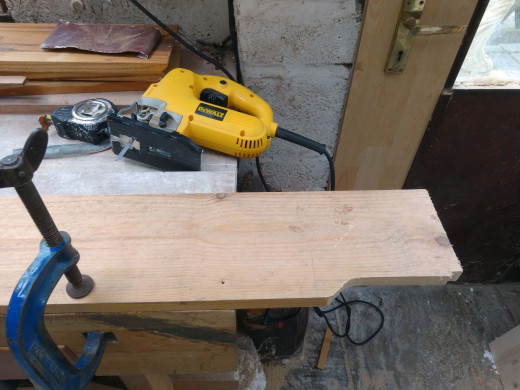 Using a jig saw to shape one of the side panels to give it style.
