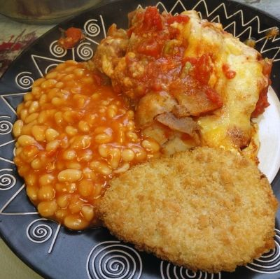 Serving Roast Potato and Cheese pie with cauliflower and cheese bake and baked beans