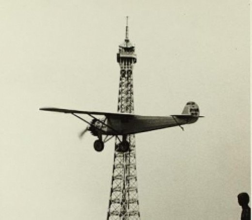 The new invention, the aeroplane, flew around the Eiffel Tower