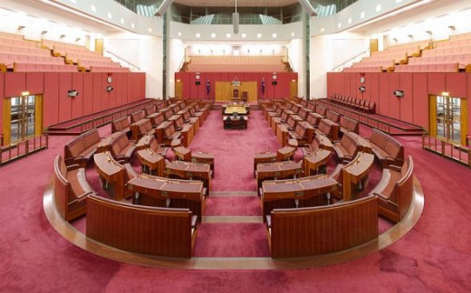 The Senate chamber is decorated in a muted red, suggesting the earth and the colours of the outback.