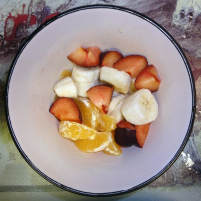 Plums, tangerines and banana for yogurt fruit salad
