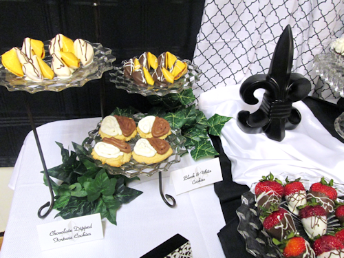 Triple plate holder with dipped fortune cookies, dipped strawberries platter on riser